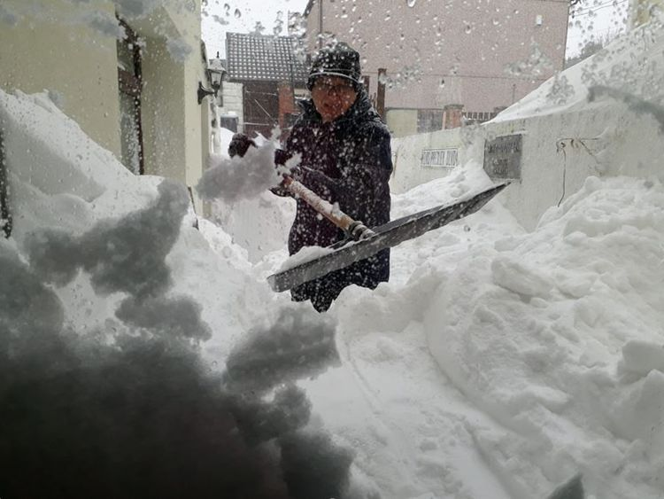 Paul Roberts was busy shovelling 7ft snow drifts in Alfred Street, Ebbw Vale, Wales, this morning. Pic: Paul and Edwina Roberts