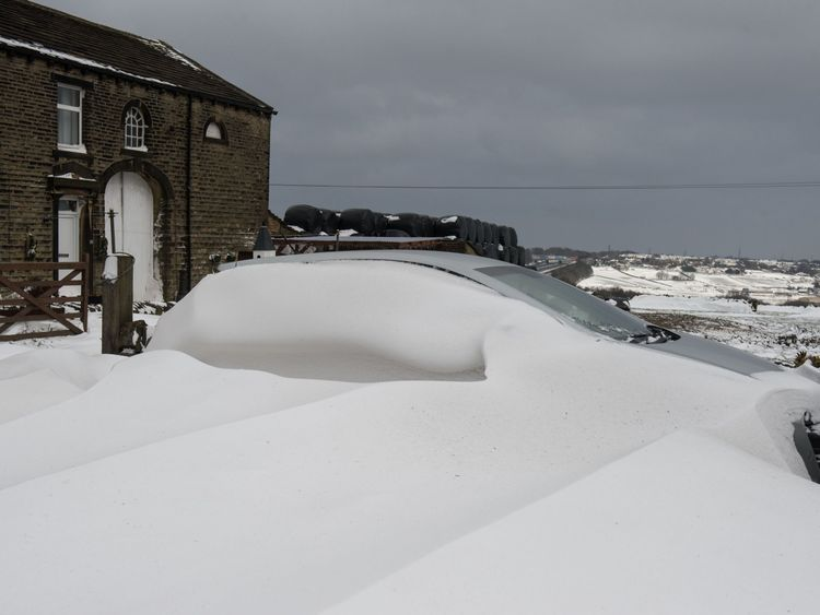 A car is buried in the village of Scapegoat Hill near Huddersfield, northern England
