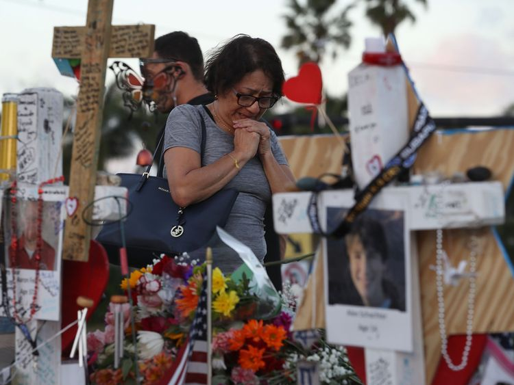 Mourners grieve after the Florida school shooting