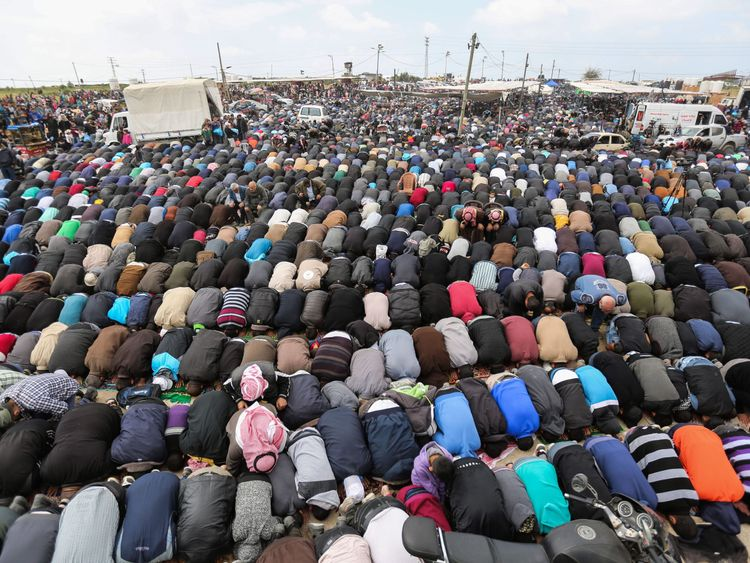Muslim worshippers perform Friday noon prayers during a tent city protest