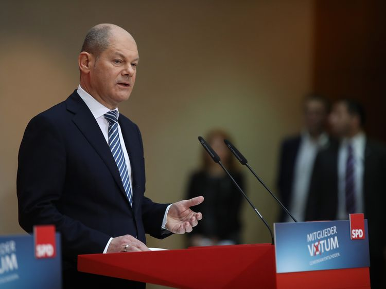 Olaf Scholz, acting chairman of the German Social Democrats, announces the vote result