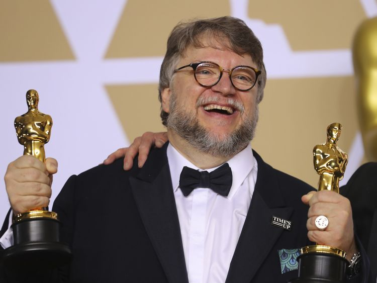 """Guillermo del Toro with the Best Director Award and the Best Picture Award for """"The Shape of Water"""""""