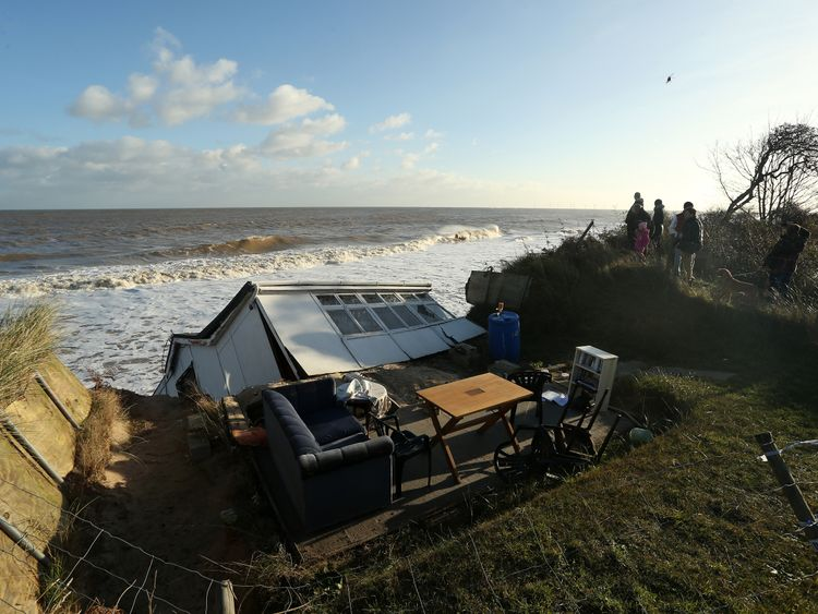 HEMSBY, ENGLAND, DECEMBER 06: The scene where properties have fallen into the sea due to the cliff collapsing on December 6, 2013 in Hemsby, England. Thousands of people were evacuated from their homes as a deadly winter storm and the highest tidal surge in 60 years hit east coast towns overnight, causing flooding and damage in many areas. (Photo by Stephen Pond/Getty Images)