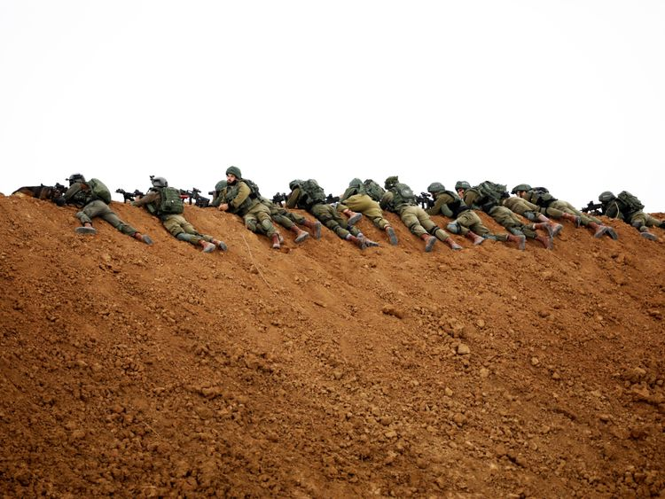 Israeli soldiers are seen near the Gaza border