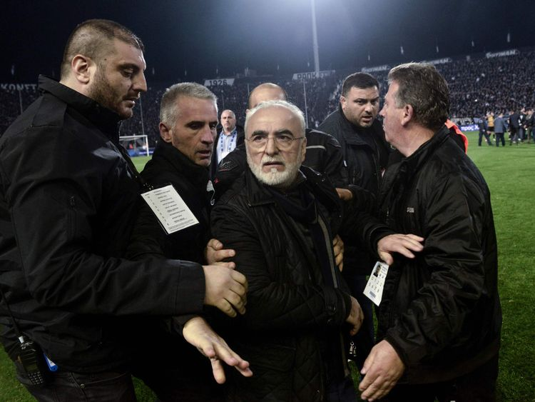 Paok boss Ivan Savvidis, centre, is escorted off the representation