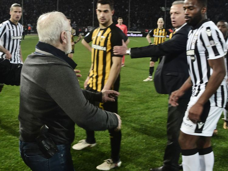 Paok boss Ivan Savvidis, centre, took to the representation after the arbitrate refused a last notation idea