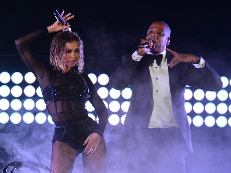 Beyonce Knowles and Jay-Z perform on stage for the 56th Grammy Awards at the Staples Center in Los Angeles, California, January 26, 2014. AFP PHOTO FREDERIC J. BROWN (Photo credit should read FREDERIC J. BROWN/AFP/Getty Images)
