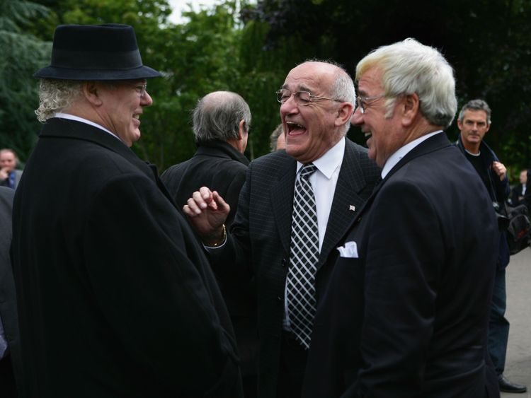Jim Bowen shares a joke with fellow comedy greats, Roy 'Chubby' Brown and Frank Carson at the funeral of another comedian Bernard Manning in 2007