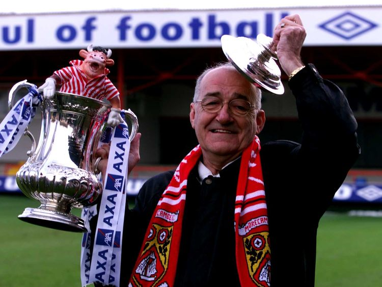 Jim Bowen was honorary president of Morecambe FC. here he is pictured with the FA Cup before a tie against Ipswich in 2001