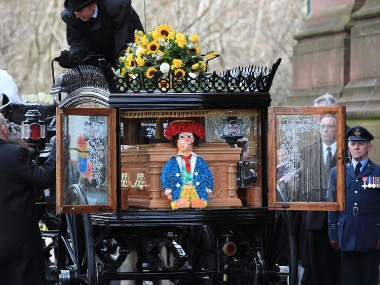 One of Sir Ken's trademark Diddymen was beside his coffin