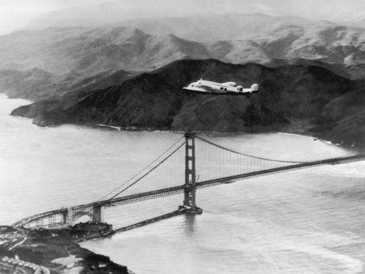 The Lockheed Electra 'Flying Laboratory', piloted by American aviator Amelia Earhart (1898 - 1937) and Fred Noonan flies over the Golden Gate bridge in Oakland, California, at the start of a planned round-the-world flight, 17th March 1937. The trip had to be abandoned after the plane crashed on take off in Hawaii