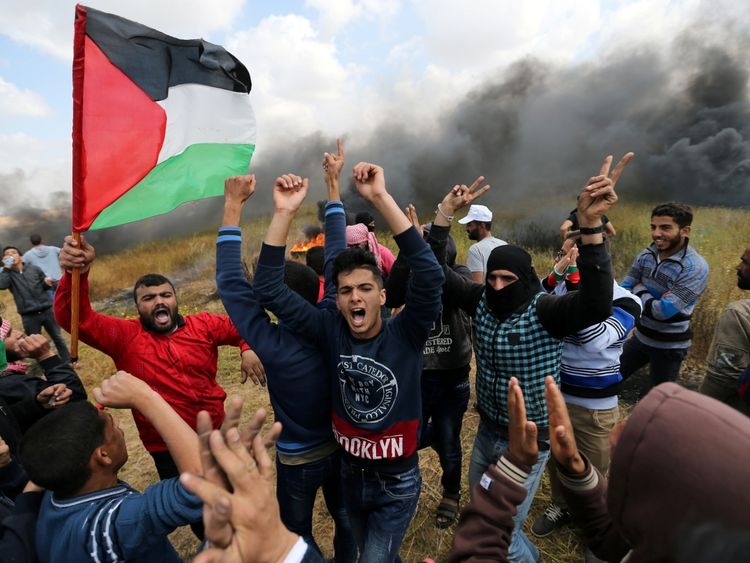 Palestinians shout during clashes with Israeli troops
