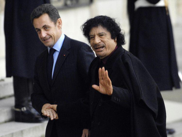 Nicolas Sarkozy (L) greets Libyan leader Moamer Kadhafi in 2007 in Paris