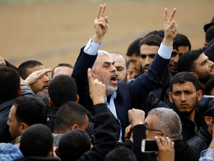 Islamist Hamas movement leader Yahya Sinwar (C) shouts slogans during the protest