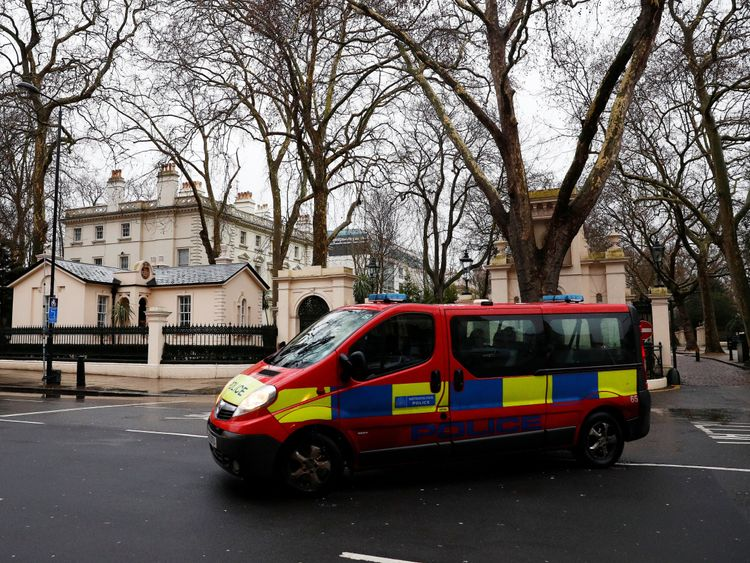A police van drives out of Kensington Palace Gardens, past Russia's Embassy in London