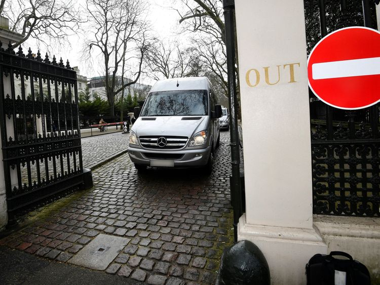 A bus carrying embassy staff and children leaves Russia's Embassy in London