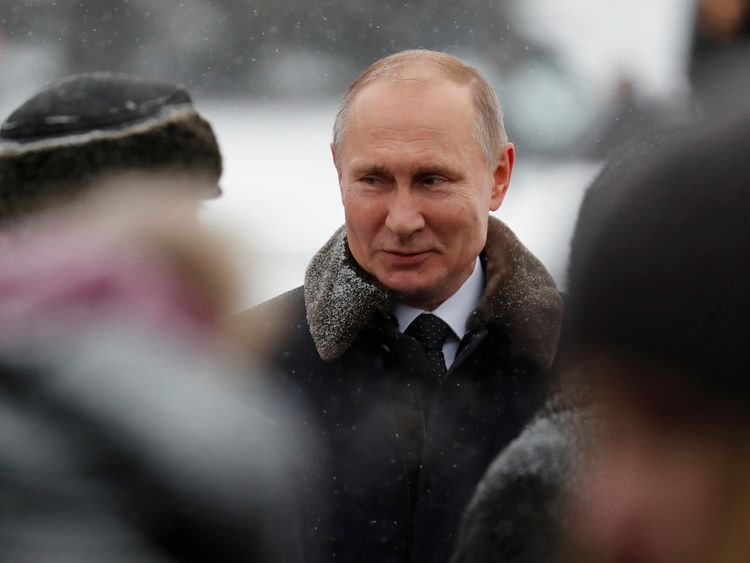 Russian President Vladimir Putin attends a flower-laying ceremony at the Piskaryovskoye Memorial Cemetery to mark the 75th anniversary of the breakthrough the Nazi Siege of Leningrad in the World War II, in St. Petersburg, Russia January 18, 2018. REUTERS/Anatoly Maltsev/Pool