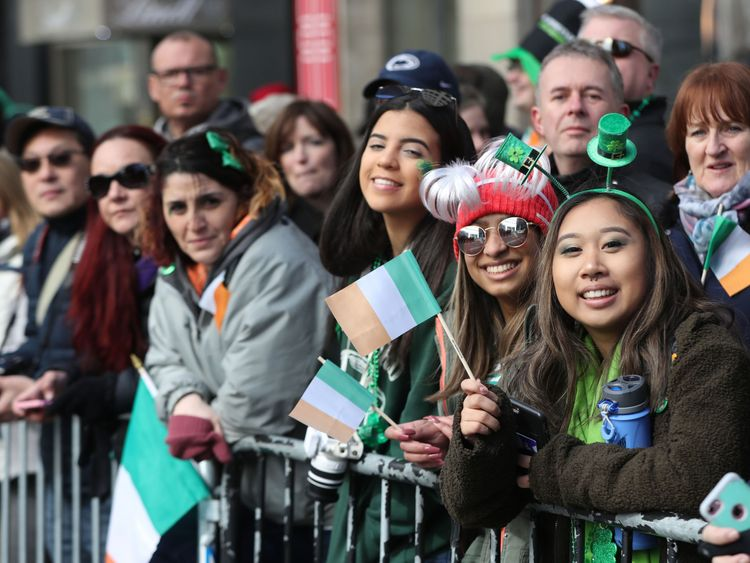 Crowds watch the St Patrick's Day parade in New York City. PRESS ASSOCIATION Photo. Picture date: Saturday March 17, 2018. See PA story IRISH Taoiseach. Photo credit should read: Niall Carson/PA Wire
