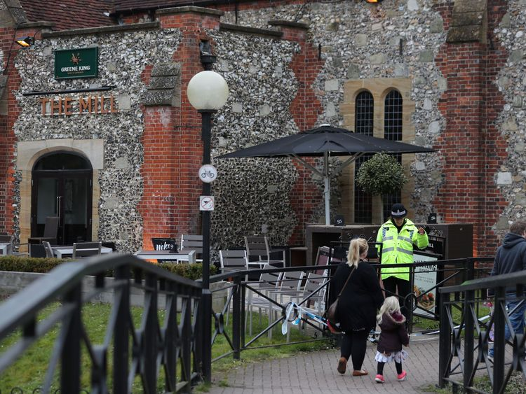 A police officer stands in front of The Mill pub in Salisbury