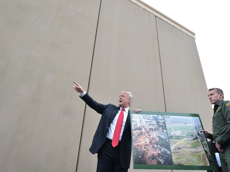 US President Donald Trump speaks during an investigation of limit wall prototypes