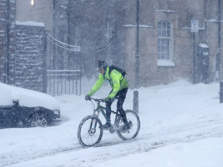 An intrepid cyclist navigates his way through the snow outside Sterling Castle in Scotland