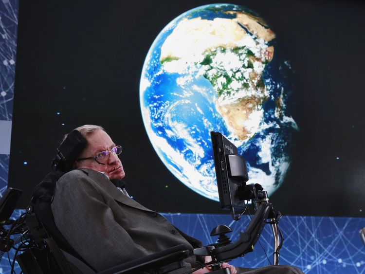 Stephen Hawking sits on stage during an announcement of the Breakthrough Starshot initiative with investor Yuri Milner in New York April 12, 2016