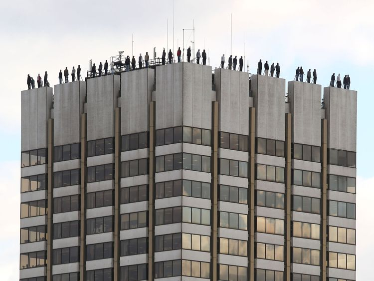 The sculptures of 84 men, made by American artist Mark Jenkins and his collaborator, Sandra Fernandez, part of Project 84, a campaign to raise awareness of the fact that 84 men take their own lives every week in the UK, ontop of London Television Centre after the installation was unveiled. PRESS ASSOCIATION Photo. Picture date: Monday March 26, 2018