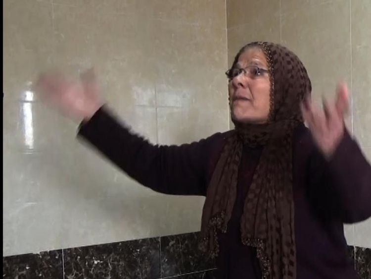 A woman mourns in a hospital in Afrin