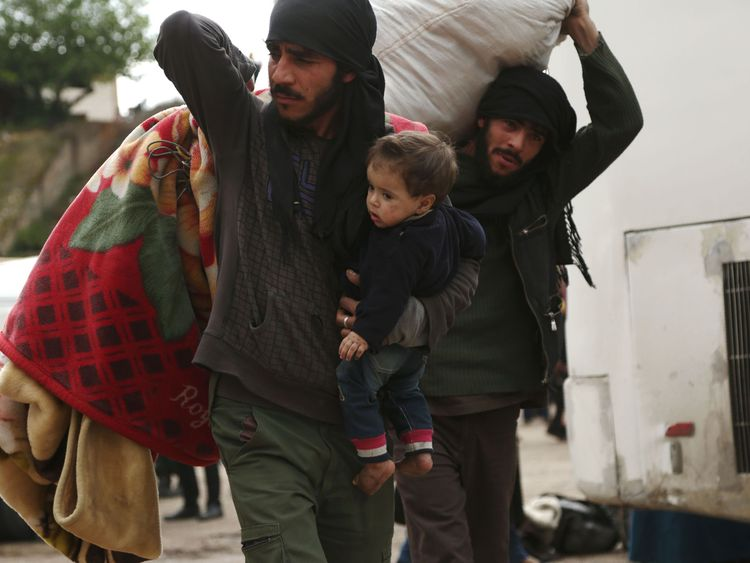 Syrian civilians and rebel fighters were evacuated from Eastern Ghouta on Sunday