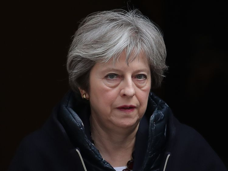 Britain's Prime Minister Theresa May leaves 10 Downing street for the weekly Prime Minister Question (PMQ) session in the House of Commons in London on March 14, 2018.