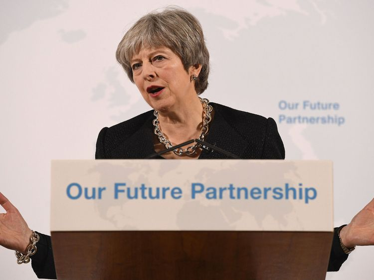 May tries to put party's Brexit divisions 'to bed'