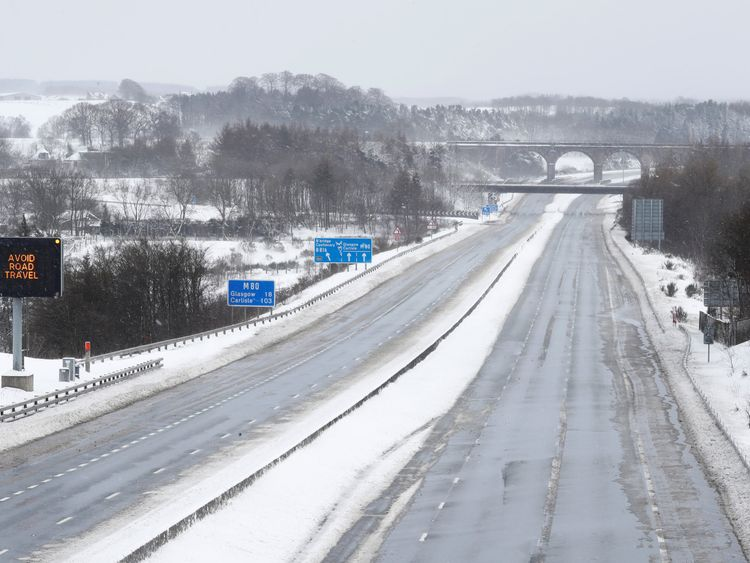 The M80 motorway is completely empty after being closed to clear vehicles stranded by bad weather overnight, near Banknock, Scotland