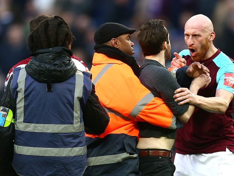 James Collins clashes with a pitch invader