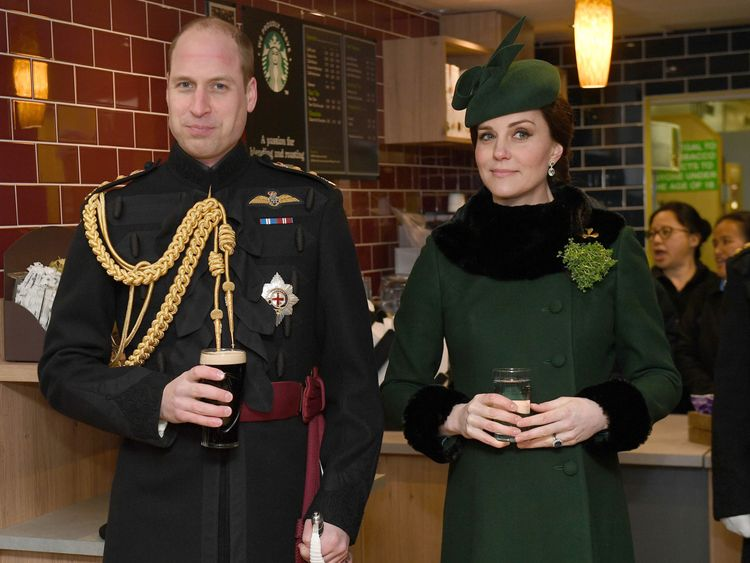 HOUNSLOW, ENGLAND - MARCH 17: Prince William, Duke Of Cambridge, Colonel of the Irish Guards drinks a pint of Guinness next to Catherine, Duchess of Cambridge as they attend the annual Irish Guards St Patrick's Day Parade at Cavalry Barracks on March 17, 2018 in Hounslow, England.  (Photo by Andrew Parsons - WPA Pool/Getty Images)