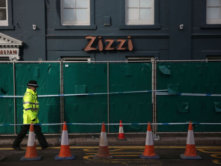 A police officer passes in front of a cordon in front of a branch of the chain Italian restaurant Zizzi in Salisbury
