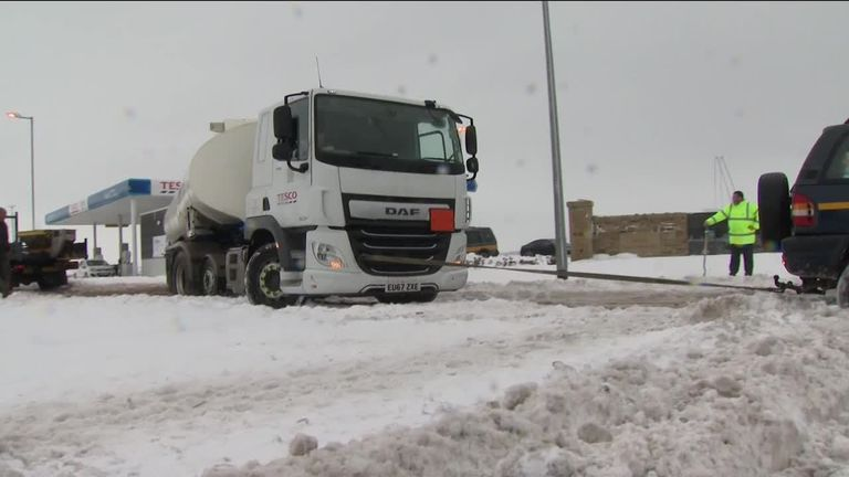 Vehicles battle against snow and black ice