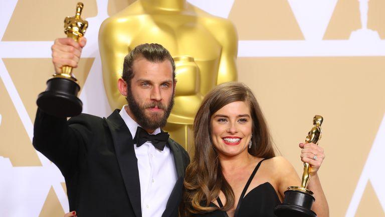 Chris Overton and Rachel Shenton hold up their Oscars