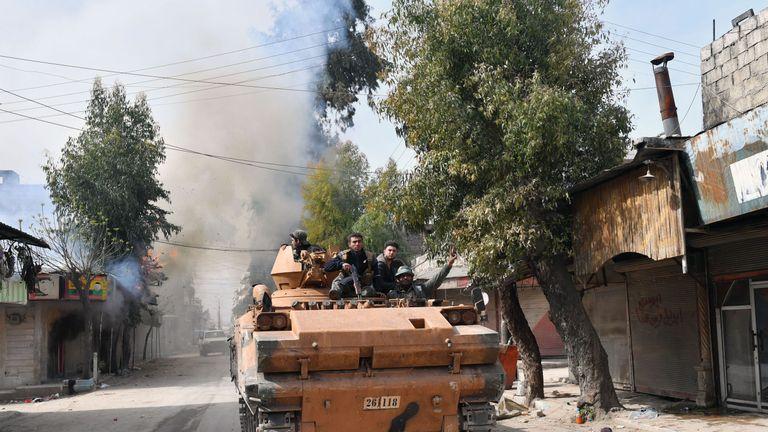 Turkish-backed Syrian rebels driving through Afrin