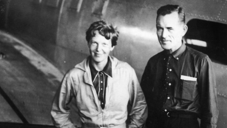American aviatrix Amelia Earhart (1897 - 1937) with her navigator, Captain Fred Noonan, in the hangar at Parnamerim airfield, Natal, Brazil, 11th June 1937
