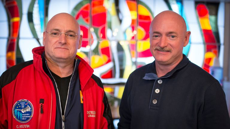 Astronaut Scott Kelly (L) and his twin mark