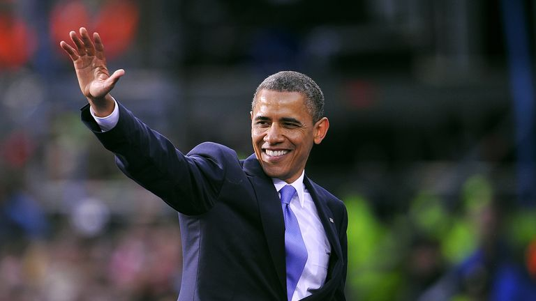 US President Barack Obama greets fans after delivering a speech to crowds of people during a public rally at College Green in Dublin, Ireland, on May 23, 2011