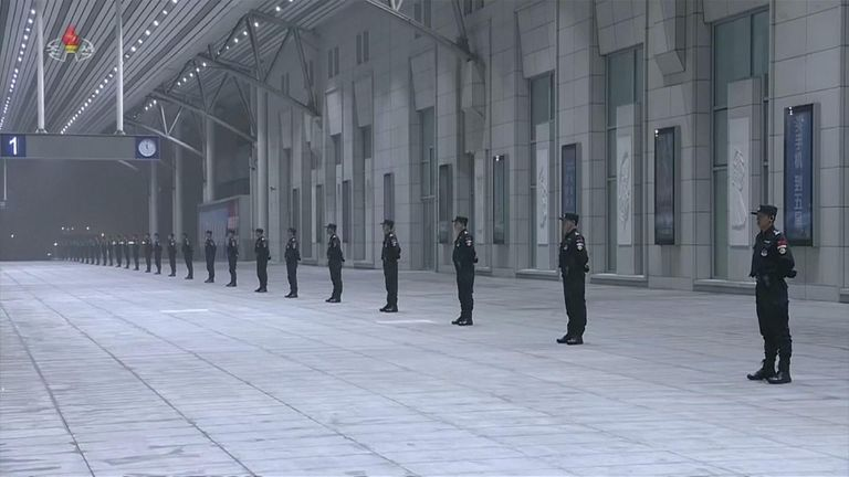 Chinese guards waited for Kim Jong Un's impending arrival at Beijing's main train station