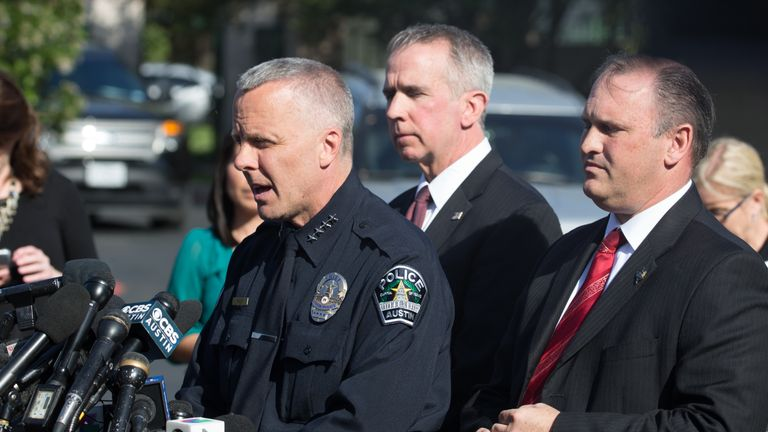 Austin Police Chief Brian Manley(L), ATF Special Agent in Charge Fred Milanowski, and FBI Agent Christopher Combs brief reporters during a press conference on March 19, 2018, in Austin, Texas