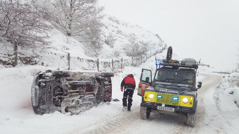 The Woodhead Mountain Rescue Team checking an overturned vehicle