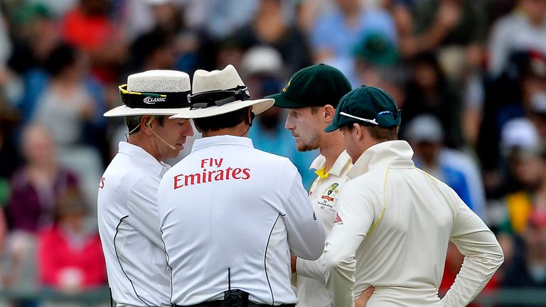 Umpires speak to Australian cricketers Cameron Bancroft and Steven Smith