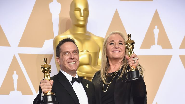 Director Lee Unkrich (L) and producer Darla K. Anderson, winners of the Animated Feature award for 'Coco'