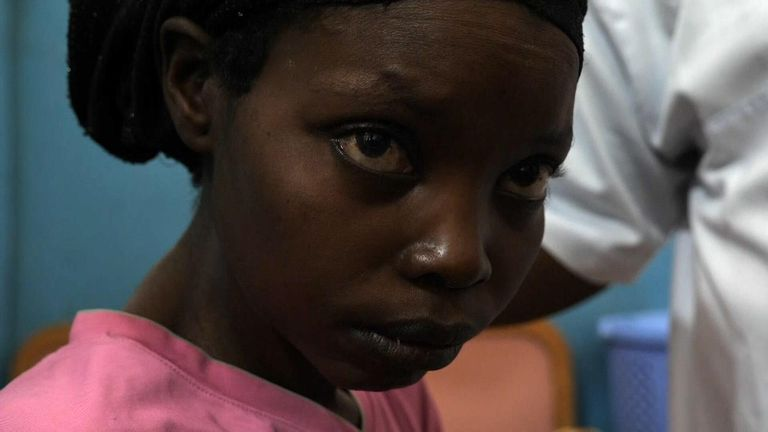 Lutove fled machete-wielding men who attacked her village
