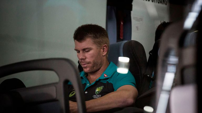 Former vice-captain David Warner of the Australian Cricket Team sits in the shuttle bus as he arrives at OR Tambo International Airport after the team was caught cheating in the Sunfoil Test Series between between Australia and South Africa on March 27, 2018. / AFP PHOTO / GULSHAN KHAN (Photo credit should read GULSHAN KHAN/AFP/Getty Images)