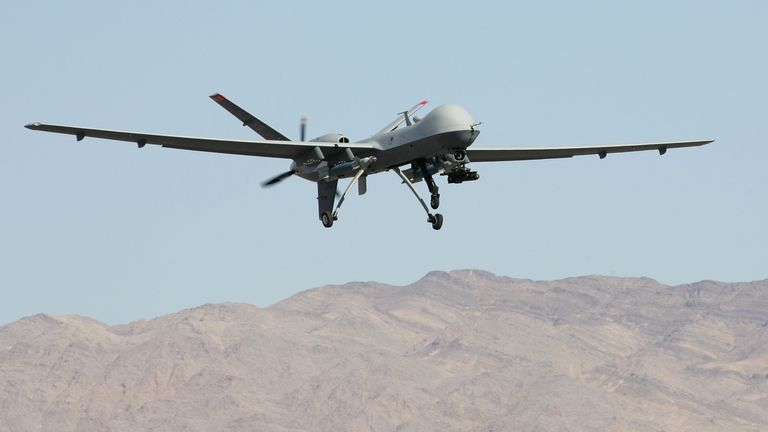 CREECH AIR FORCE BASE, NV - AUGUST 08: An MQ-9 Reaper takes off August 8, 2007 at Creech Air Force Base in Indian Springs, Nevada. The Reaper is the Air Force's first 'hunter-killer' unmanned aerial vehicle (UAV), designed to engage time-sensitive targets on the battlefield as well as provide intelligence and surveillance. The jet-fighter sized Reapers are 36 feet long with 66-foot wingspans and can fly for up to 14 hours fully loaded with laser-guided bombs and air-to-ground missiles. They can