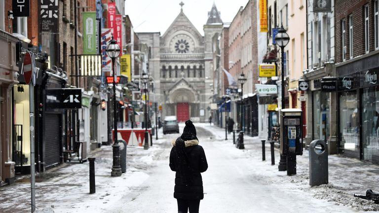 A woman on an empty street in Dublin